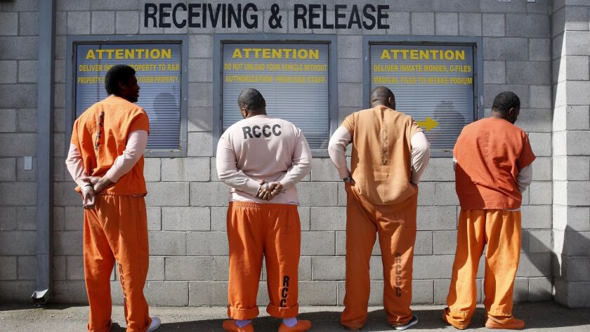 Prisoners from Sacramento County await processing after arriving at the Deuel Vocational Institution in Tracy, Calif., on Feb. 20, 2014.