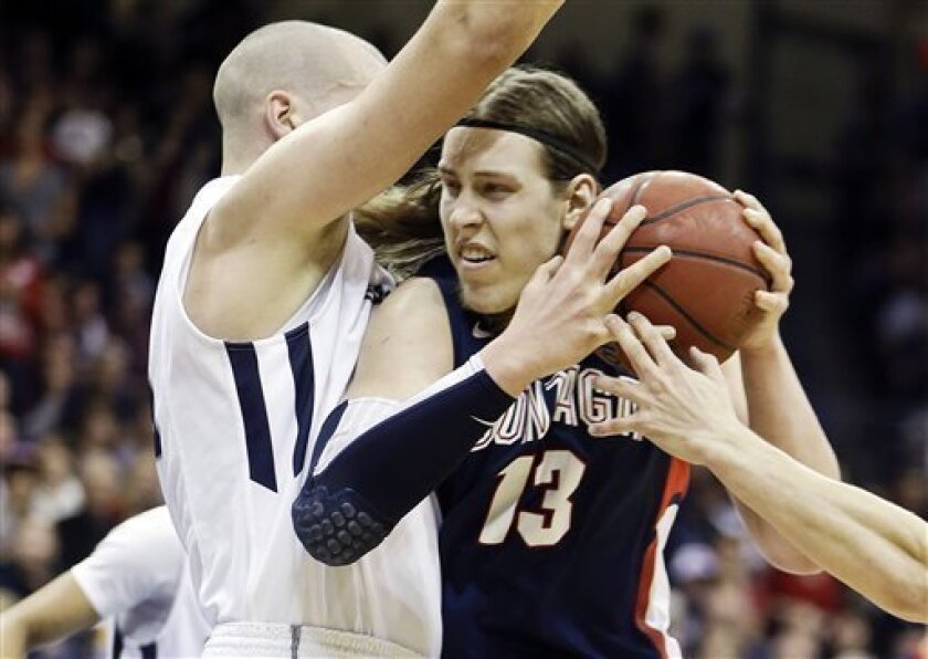 Gonzaga forward Kelly Olynyk has his path blocked by San Diego's Dennis Kramer while driving the lane during the first half of an NCAA college basketball game on Saturday Feb. 2, 2013, in San Diego. (AP Photo/Lenny Ignelzi)