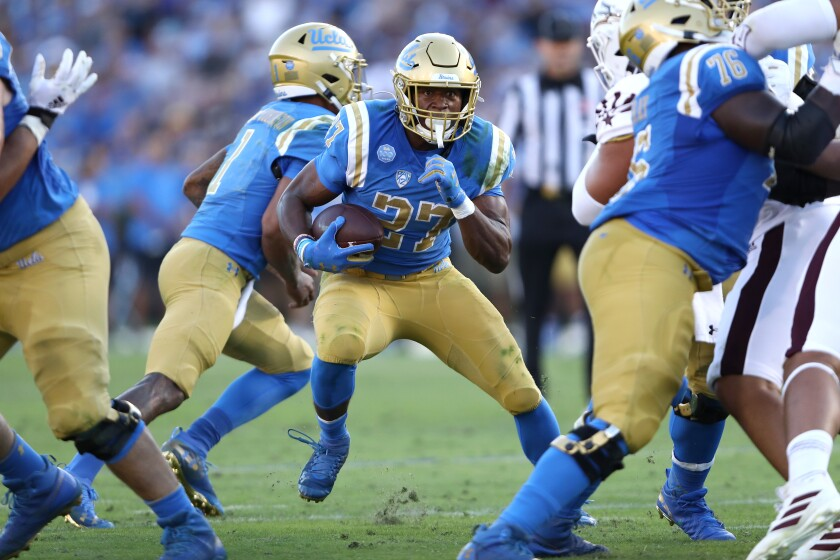 UCLA running back Joshua Kelley carries the ball
