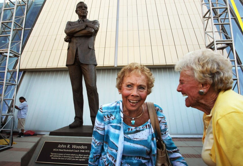 Nan Wooden, left,  enjoys a light moment with friend Mary Lou Smith at the unveiling of her father John Wooden's statue.
