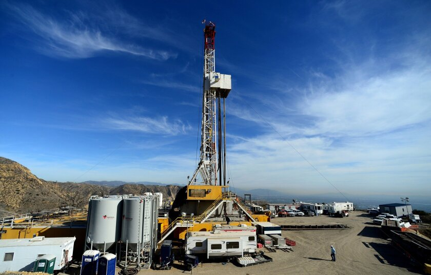 FILE - In this Dec. 9, 2015, pool file photo, crews work on stopping a gas leak at a relief well at the Aliso Canyon facility above the Porter Ranch area of Los Angeles.The utility says it has stopped the natural gas leak near Los Angeles after nearly 4 months. (Dean Musgrove/Los Angeles Daily News
