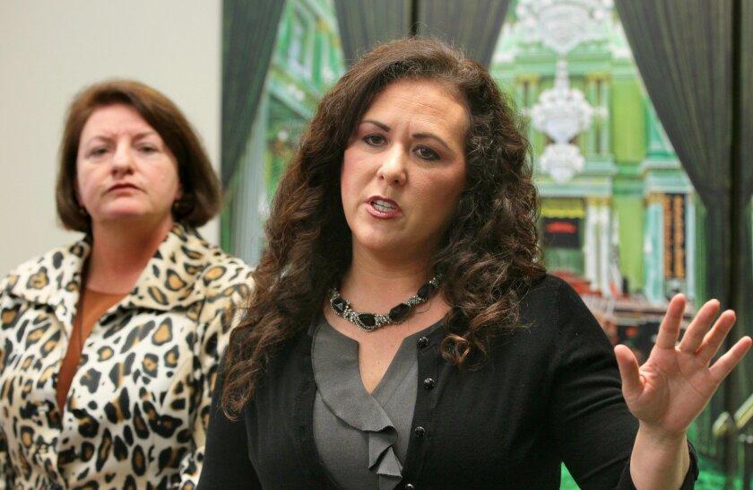 Lorena Gonzalez  speaks, at left is Toni Atkins.