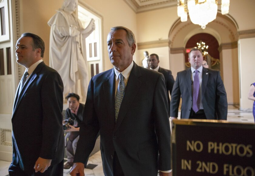 Speaker of the House John A. Boehner (R-Ohio) walks to the chamber as the House failed to advance a short-term funding measure to keep the Department of Homeland Security funded past a midnight deadline.