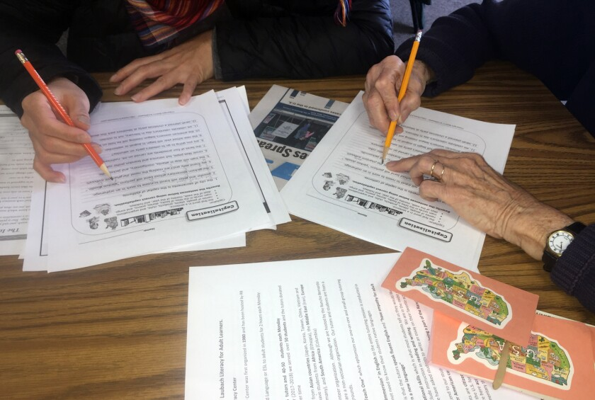 2South Korea native Heejung Kim, left, and tutor Joyce Hartman go over grammar worksheets during an English as as second language class on Monday at the Rancho Bernardo Literacy Center.