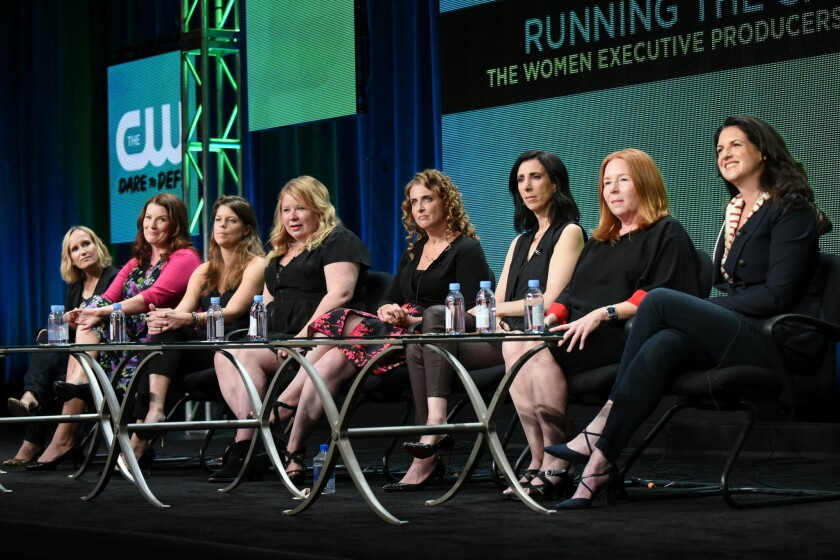 "From left, CW executive producers, Wendy Mericle (""Arrow""), Diane Ruggiero-Wright (""iZombie), Caroline Dries (""The Vampire Diaries""), Julie Plec (""The Vampire Diaries"" and ""The Originals""), Jennie Snyder Urman (""Jane the Virgin""), Aline Brosh McKenna (""Crazy Ex-Girlfriend), Laurie McCarthy (""Reign"") and Gabrielle Stanton (""The Flash"") participate in the ""Running the Show: The Women Executive Producers of The CW"" panel at The CW Summer TCA Tour at the Beverly Hilton Hotel on Aug. 11, 2015."
