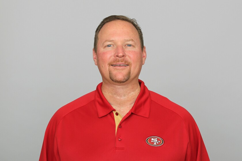 Tim Drevno as an assistant coach with the San Francisco 49ers.
