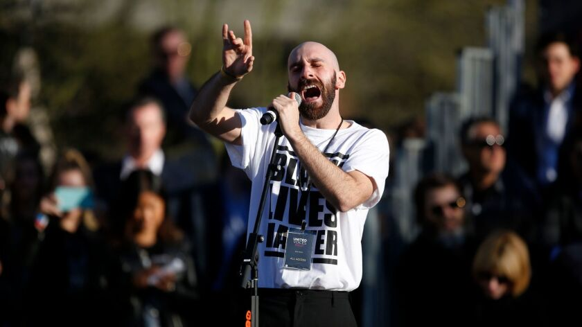 Sam Harris of X Ambassadors performs at the United Voices rally organized by United Talent Agency.