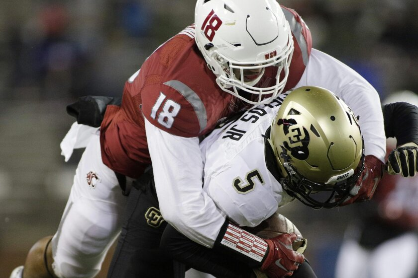 Washington State safety Shalom Luani (18) brings down Colorado wide receiver Shay Fields (5) during the second half of an NCAA college football game, Saturday, Nov. 21, 2015, in Pullman, Wash. Washington State won 27-3. (AP Photo/Young Kwak)
