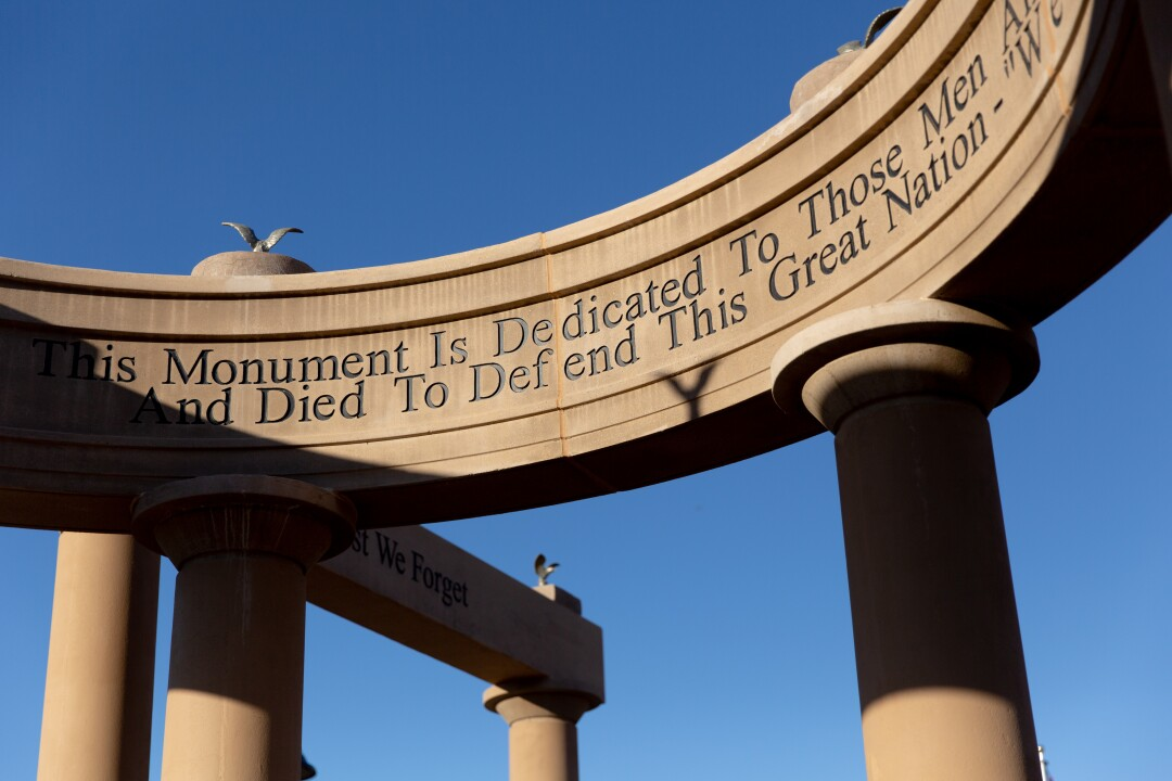 A monument with columns dedicated to those who died defending the U.S.