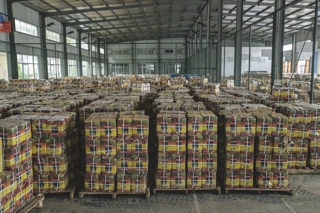 Boxes of soaked tea unfit for sale await disposal at a factory in Shexian, Anhui province.