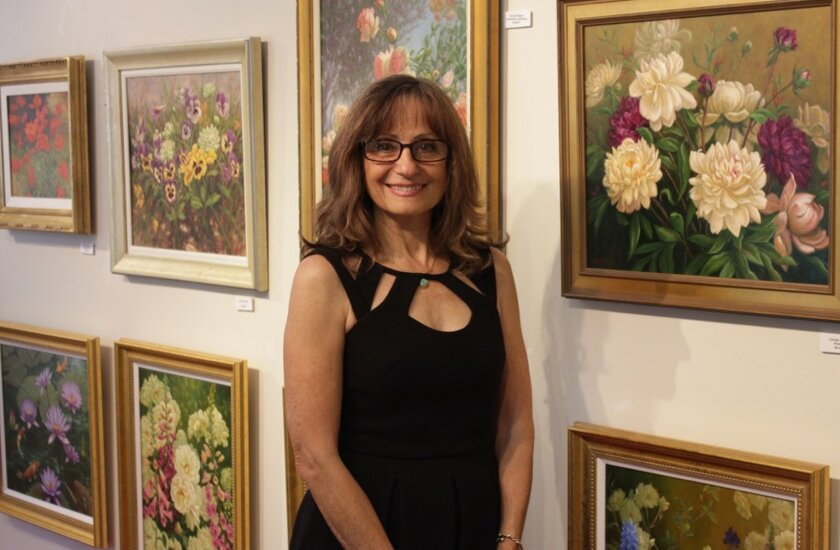 Encinitas artist Carole Mayne with some of her work.