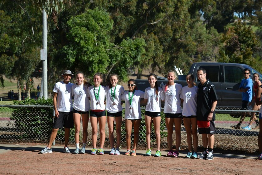 The Canyon Crest Academy girls varsity cross country team competed in the CIF San Diego Section Division 2 Championship on Nov. 21. L-R: Coach Rob Lusitana, Kelly Bernd, Corinne Chapkis, Claire Bernd, Maya Tantuwaya, Kira Loren, Naomi Smitham, Samantha Ortega, Coach Andrew Corman.