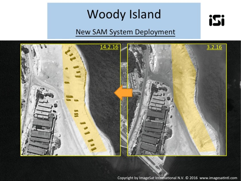 This image with notations provided by ImageSat International N.V., Wednesday, Feb. 17, 2016, shows satellite images of Woody Island, the largest of the Paracel Islands, in the South China Sea. A U.S. official confirmed that China has placed a surface-to-air missile system on Woody Island in the Par