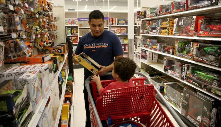 Christian Andalcio and son Sebastian shop for toys Sept. 6 at the Target store in Broadview.