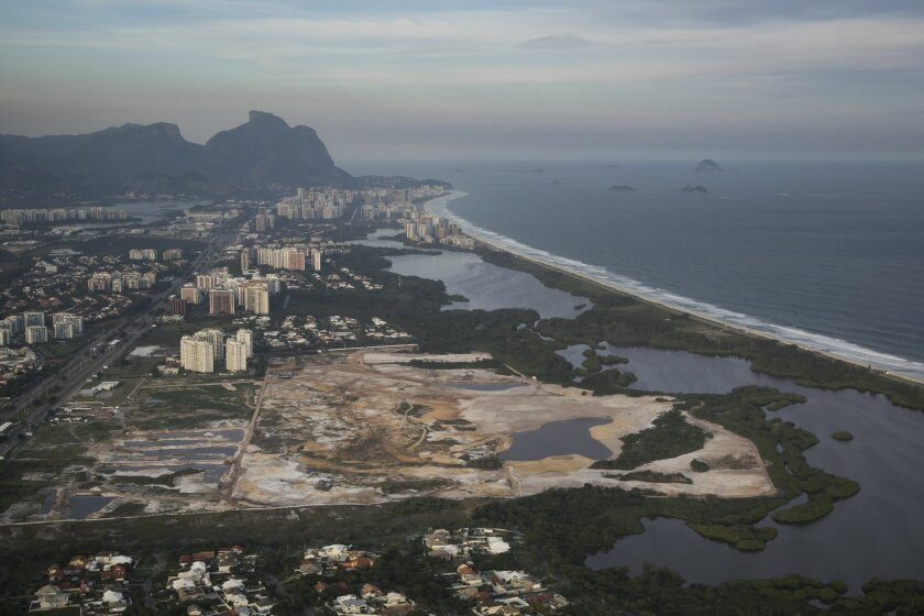 FILE - This May 13, 2014 file photo shows the Rio 2016 Olympic golf course under construction in Rio de Janeiro, Brazil. A Rio de Janeiro public prosecutor opened an inquiry on Feb. 6, 2015 into alleged misconduct by Mayor Eduardo Paes over the construction of the golf course for the 2016 Olympics in a nature reserve. (AP Photo/Felipe Dana, File)