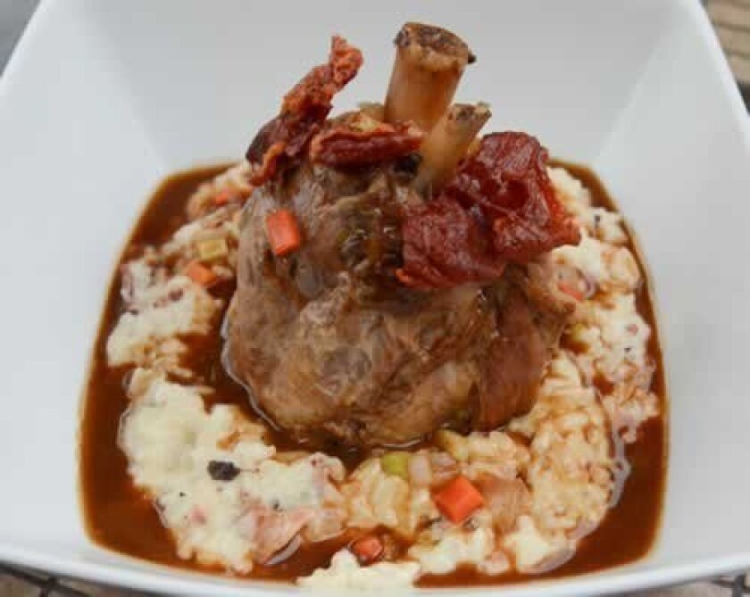 Braised Pork Shank, stationed in a bed of bacon and asiago risotto, and accented with cracklins. Photos by Kelley Carlson