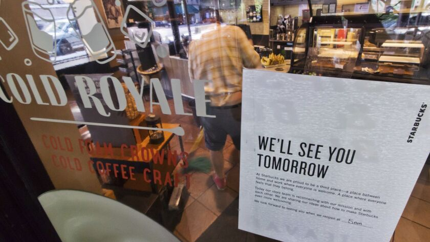 A sign advising that a Starbucks is closed, is posted in the window of a store on New York's West Si