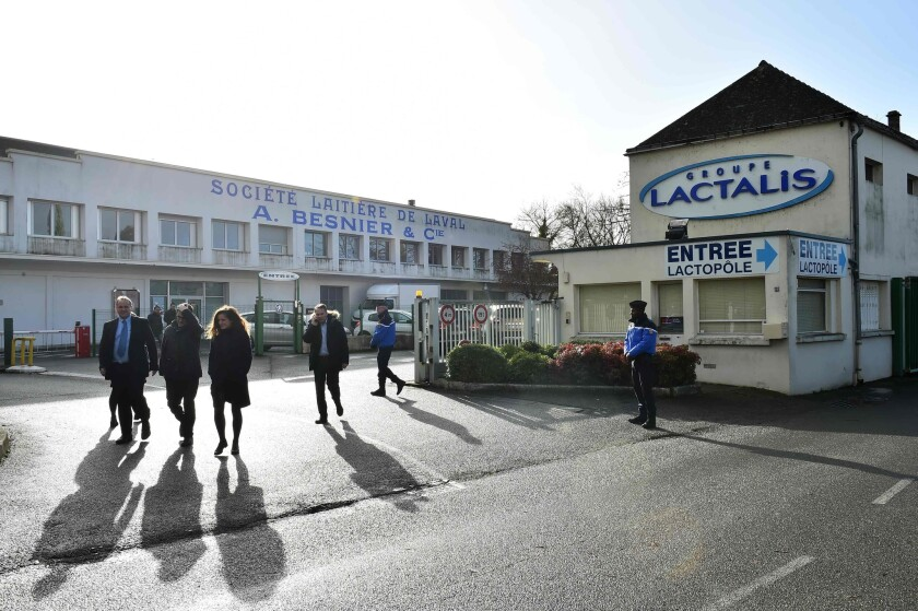 Workers leave the Lactalis Group headquarters, in Laval, northwestern France, on January 17, 2018. French police raided the headquarters of dairy giant Lactalis today over a baby milk salmonella scare that has sickened dozens of children and led to a major international recall. Dozens of police were searching the company's offices in Laval, western France, as well as its factory in nearby Craon which was the source of the tainted milk.