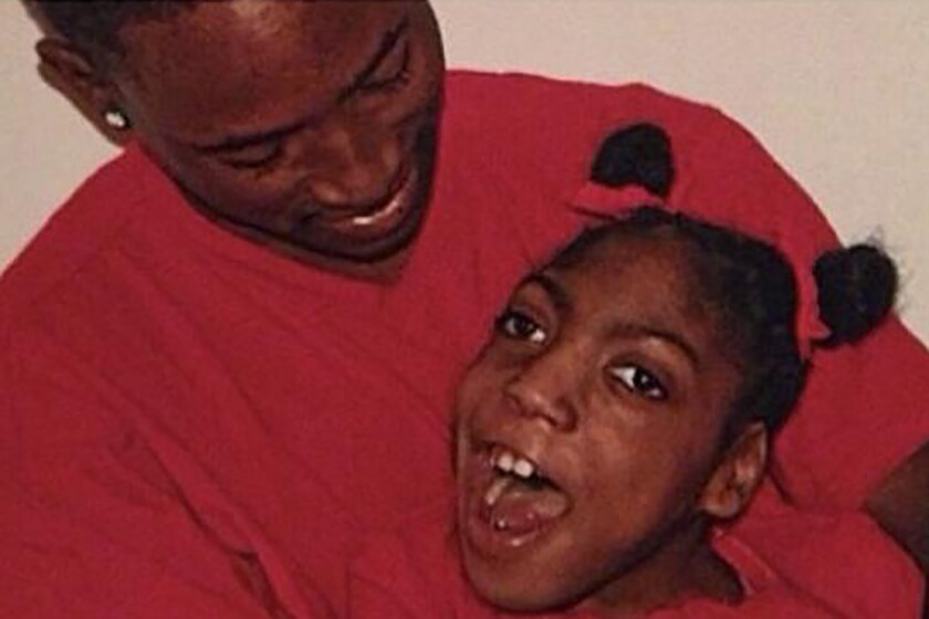 In this undated family photo provided by Erica Lattimore through Fieger Law shows her daughter, Timesha Beauchamp with her brother Steven Thompson in Southfield, Mich. An attorney for the family of a young woman found breathing at a Detroit funeral home after being declared dead says the 20-year-old was in a body bag for some two hours before it was opened and she was discovered to be alive. Geoffrey Fieger, who was hired by Timesha Beauchamp's family, said Tuesday, Aug. 25, 2020 the Southfield woman hospitalized in critical condition and is on a respirator. (Courtesy Erica Lattimore through Fieger Law via AP)