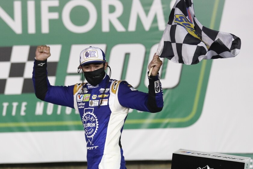 Chase Elliott celebrates after winning a NASCAR Cup race at Charlotte Motor Speedway on Thursday.