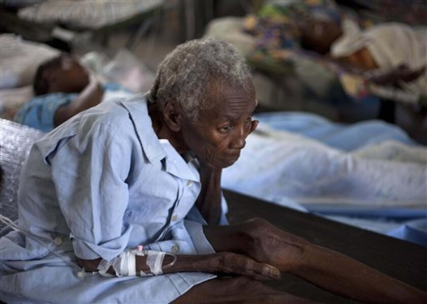 A woman suffering from cholera symptoms is treated at the St. Nicholas hospital in Saint Marc, Haiti, Monday, Nov. 8, 2010. After at least 20 people died when Hurricane Tomas brushed past Haiti, officials are now turning their attention back to a worsening cholera epidemic that has killed more than 500 people and hospitalized more than 7,300.(AP Photo/Ramon Espinosa)