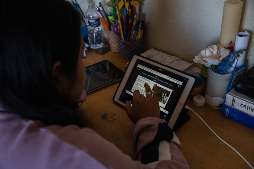 Citlali Medina takes a virtual government class while sitting at her desk at home in Escondido on November 10, 2020.