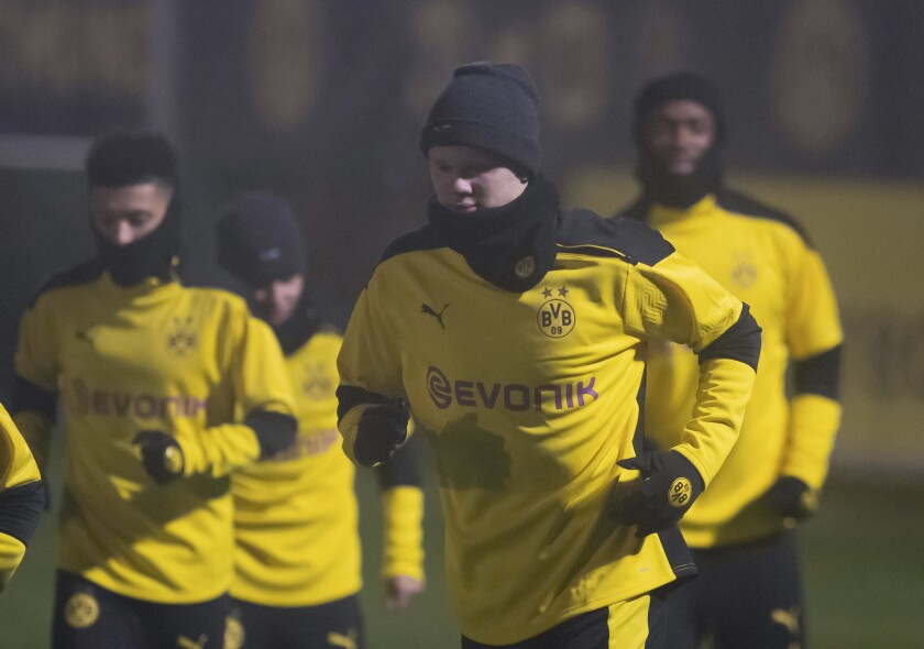 Erling Haaland, center, and other players of Dortmund attend a training session at the Signal Iduna Park station at the eve of the Champions League group F soccer match between Borussia Dortmund and Lazio Rome in Dortmund, Germany, Tuesday, Dec. 1, 2020. (Bernd Thissen/dpa via AP)