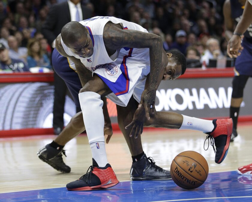 Los Angeles Clippers' Jamal Crawford, front, sports a pair of his signature Brandblack J. Crossover II sneakers as he tangles with the Memphis Grizzlies' Tony Allen in a February game in Los Angeles.