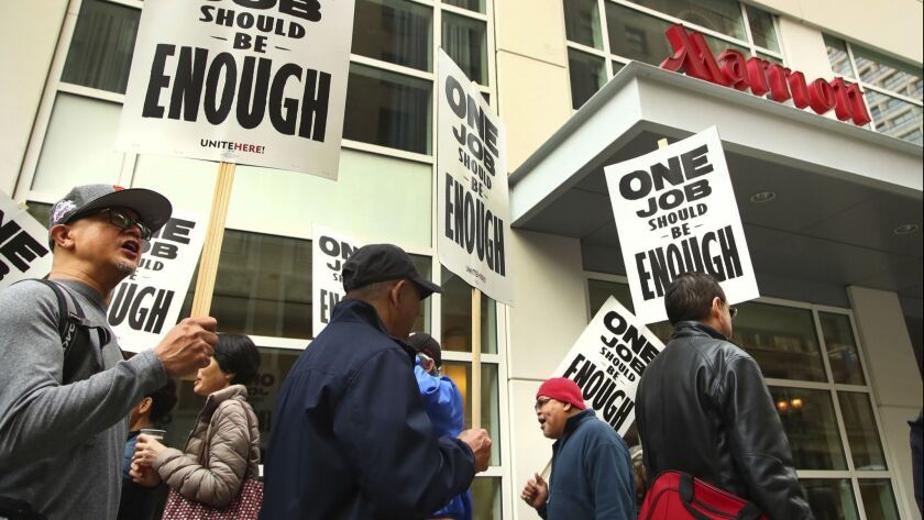 Hotel workers picket in front of a Marriott hotel in San Francisco during the strike there, which was settled in early December. Now two dozen Southern California hotels face the possibility of a strike as early as Wednesday.