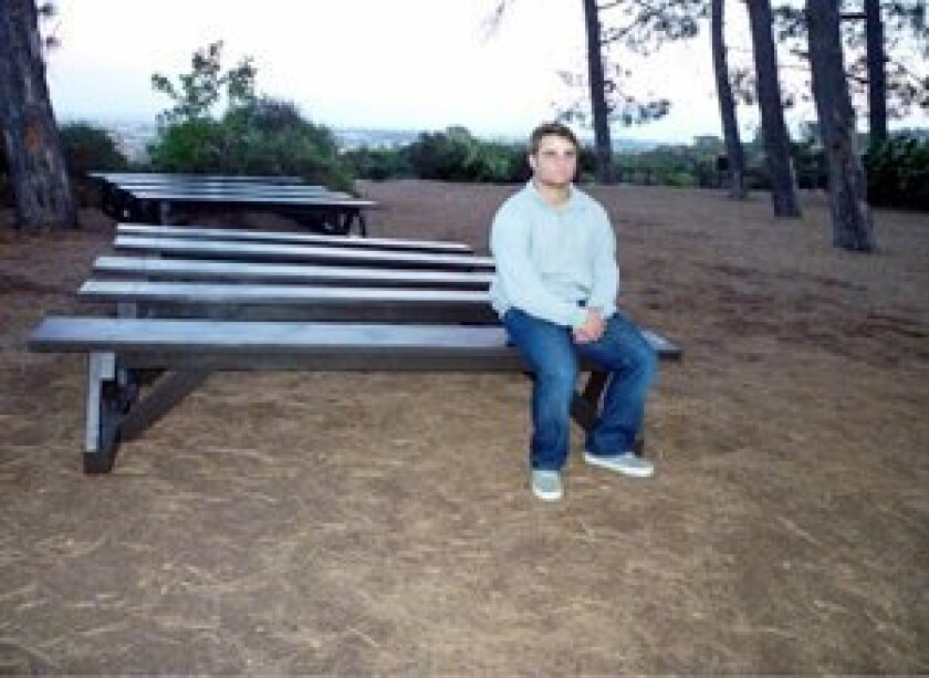 Boy Scout Drew Dohn with some of the benches that he and friends built for Torrey Pines State Park.