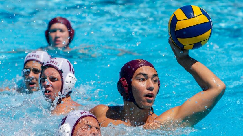 Bishop's Chris Lee takes a shot on goal in front of several Point Loma defenders during the champion