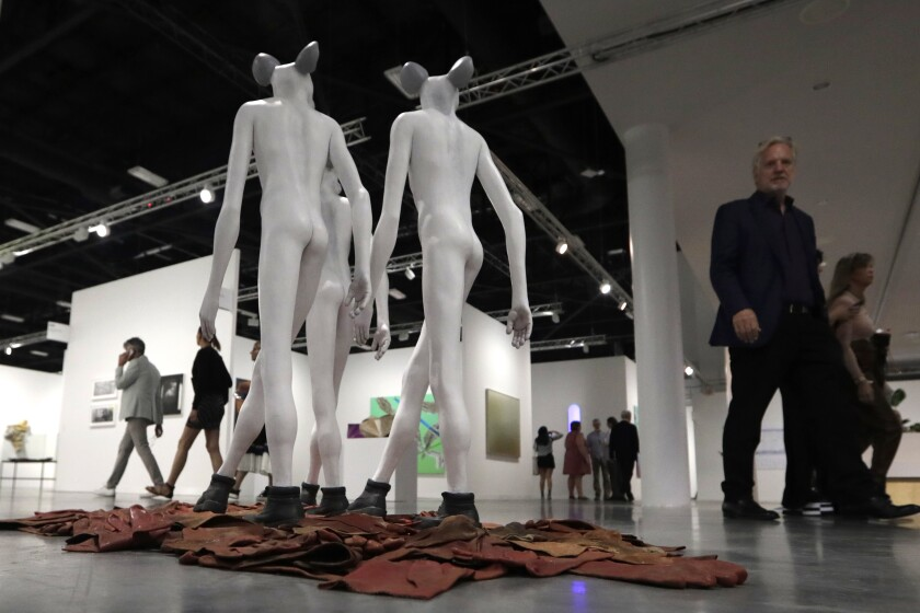 FILE - In this Dec. 4, 2019, file photo, a sculpture by artist Jane Alexander with the Stevenson Gallery is shown during Art Basel Miami Beach, in Miami Beach, Fla. According to a statement released Wednesday, Sept. 2, 2020, the Art Basel fair, known for glamorous parties and celebrity sightings, is cancelling its annual Miami event amid the coronavirus pandemic. (AP Photo/Lynne Sladky, File)