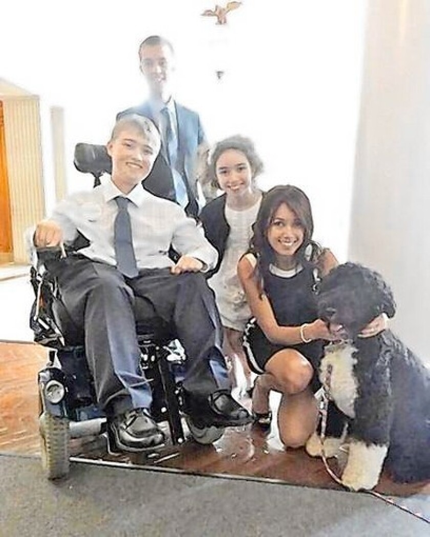 Dusty Brandom, in chair, surrounded by his family Lucas, Gabriella, Cath and First Dog Bo at the White House.