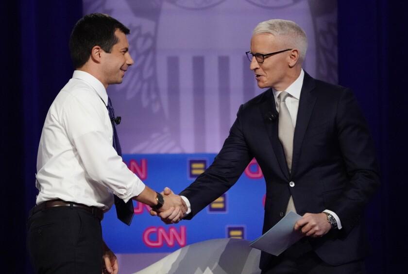 Pete Buttigieg greets Anderson Cooper