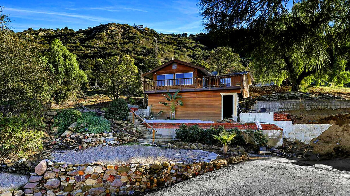 SIMI VALLEY: Nestled in the mountains on a quarter-acre lot, this hillside retreat has a wraparound balcony to take in the views. Address: 6834 Santa Susana Pass Road, Simi Valley, 93063 Listed for: $599,999 for two bedrooms, 1.5 bathrooms in 936 square feet (8,198-square-foot lot) Features: Updated interior; kitchen with custom cabinetry; mountain views; tiered backyard About the area: In the 93063 ZIP Code, based on 43 sales, the median price for single-family homes in December was $550,000, down 5.2% year over year, according to CoreLogic.