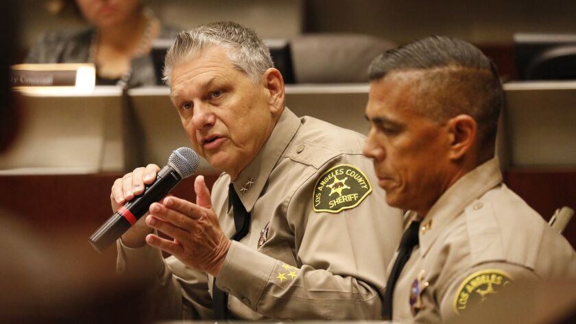 L.A. County Sheriff's Chief John Benedict, left, and Capt. Robert Lewis address the Sheriff Civilian Oversight Commission to discuss concerns of racial profiling by a highway enforcement team on the 5 Freeway.
