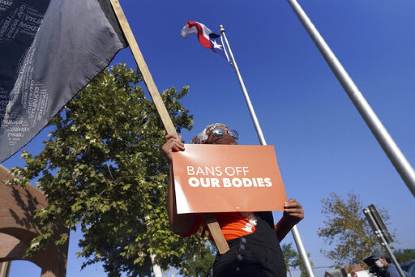 Rachel Hernandez chants with abortion rights supporters as they protest SB 8 in front of Edinburg City Hall on Wednesday, Sept. 1, 2021, in Edinburg, Texas. The nation's most far-reaching curb on abortions since they were legalized a half-century ago took effect Wednesday in Texas, with the Supreme Court silent on an emergency appeal to put the law on hold.(Joel Martinez/The Monitor via AP)