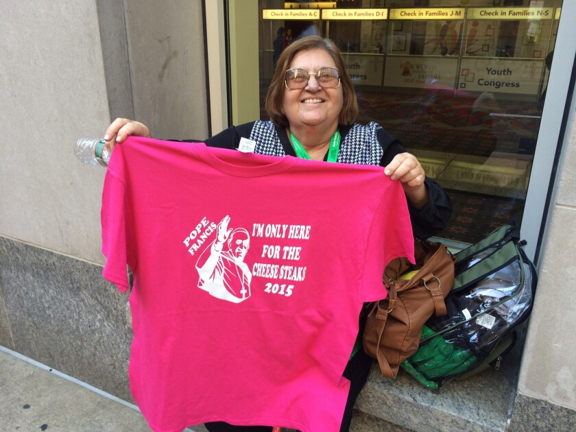 """Marta Priede, 68, came to Philadelphia from West Palm Beach, Fla., to see the pope. On Wednesday, she bought souvenirs, including this T-shirt and a button that says, """"I was there."""""""