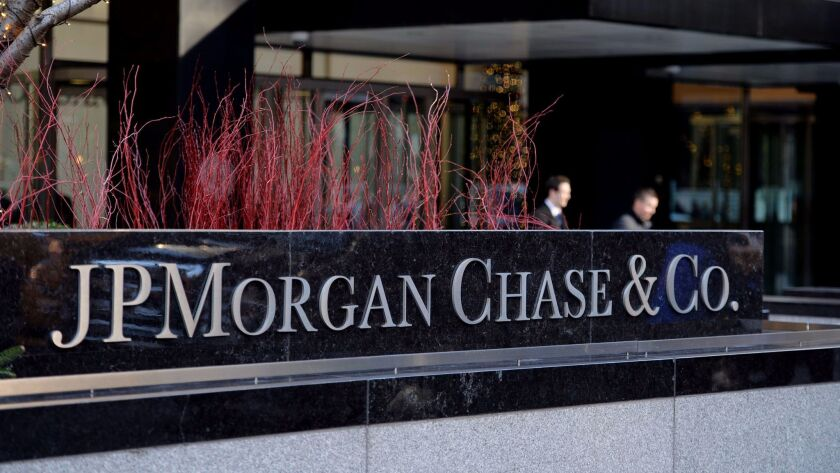 (FILES)This December 12, 2013 file photo shows the headquarters of JP Morgan Chase on Park Avenue in