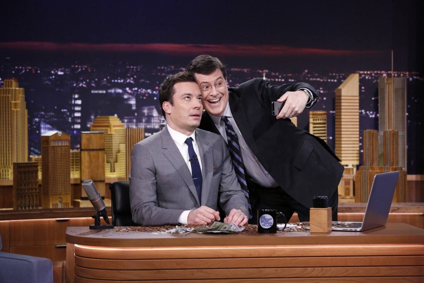 """Fellow talk show host Stephen Colbert shamelessly takes a selfie with Jimmy Fallon, who rolled out his first show as host of NBC's """"The Tonight Show."""" The program was previously hosted by Jay Leno."""