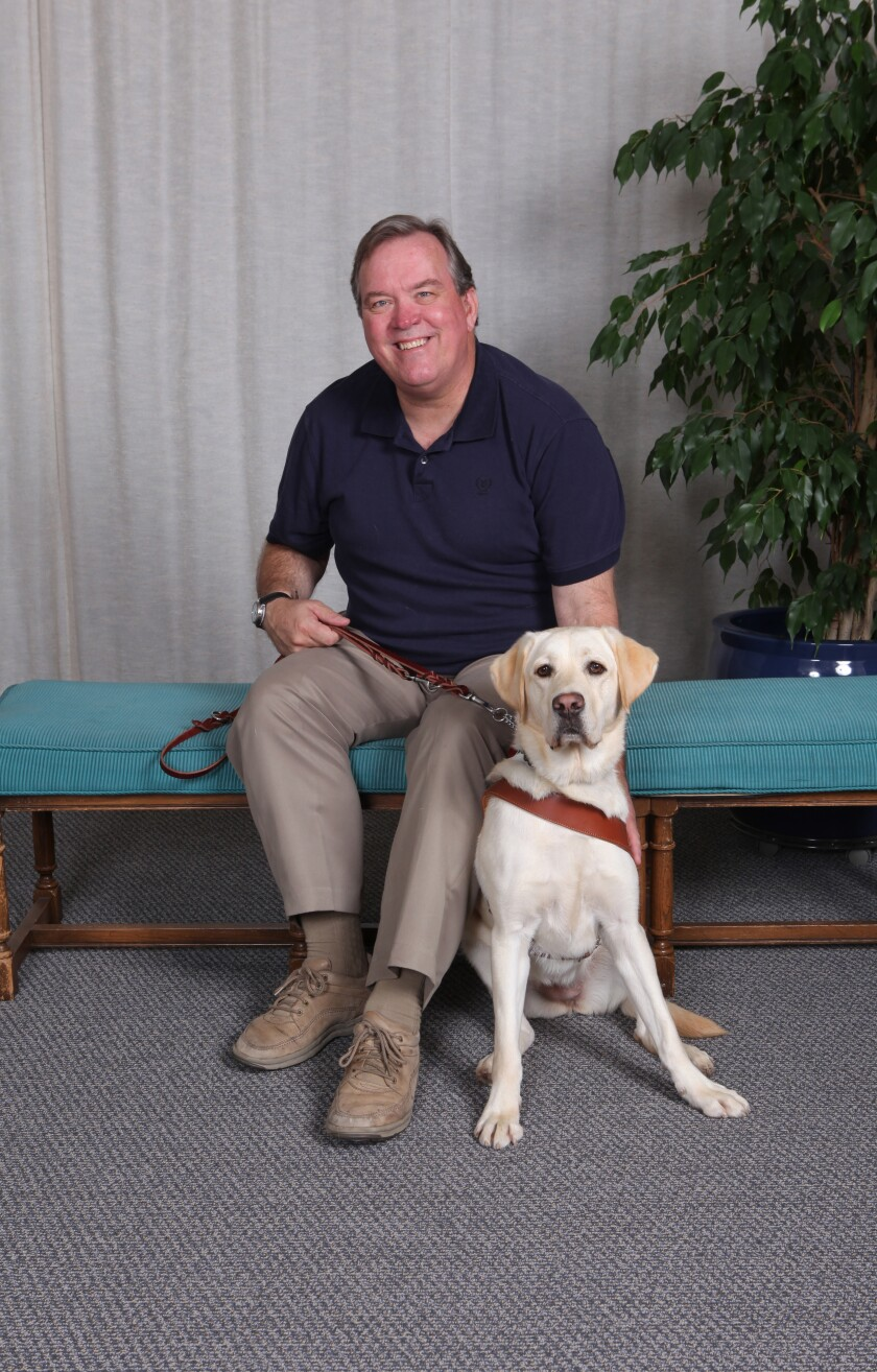 Mark Carlson with his current dog, Saffy.