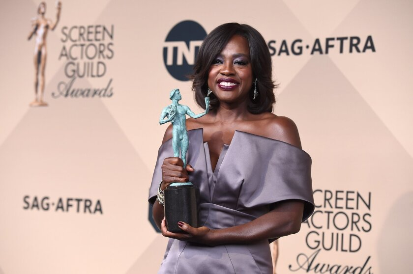 "Viola Davis poses in the press room with the award for outstanding female actor in a drama series for ""How to Get Away with Murder"" at the 22nd annual Screen Actors Guild Awards at the Shrine Auditorium & Expo Hall on Saturday, Jan. 30, 2016, in Los Angeles. (Photo by Jordan Strauss/Invision/AP)"