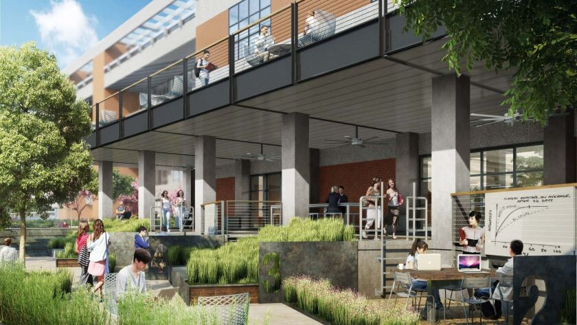 Former loading docks are turned into an outdoor work and lounging space.
