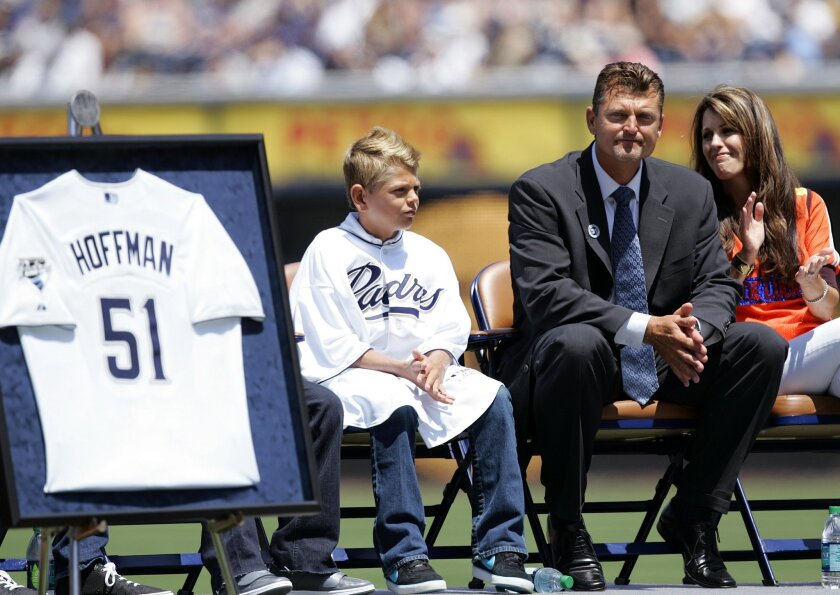Former padres pitcher Trevor Hoffman looks up at the crowd during a ceremony to retire his number 51 at Petco Park on Sunday.