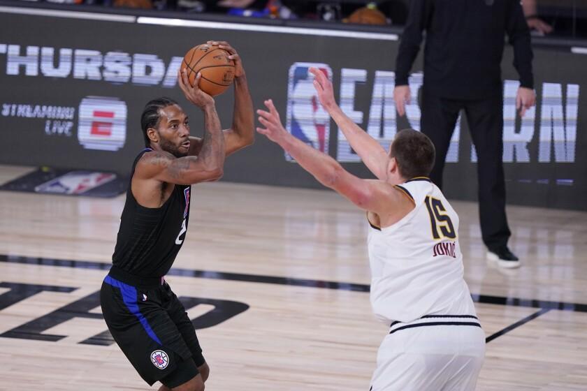 Clippers forward Kawhi Leonard shoots over Nuggets center Nikola Jokic during Game 7 on Sept. 15, 2020.