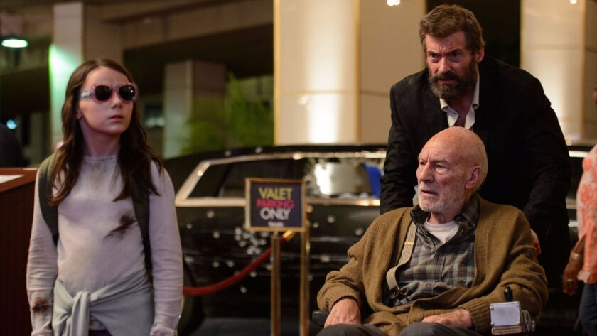 "Dafne Keen as Laura, Hugh Jackman as Logan / Wolverine and Patrick Stewart as Charles in ""Logan."""