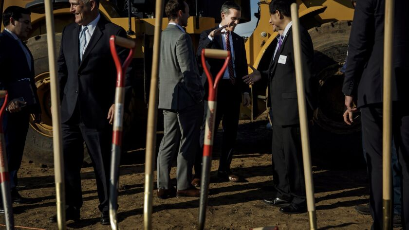 Mayor Eric Garcetti, center, at a groundbreaking ceremony for a 160-unit affordable apartment project next to the 110 Freeway in South Los Angeles on Jan. 26, 2017.