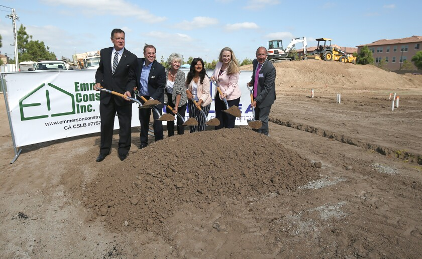 From left, Orange County Supervisor Donald Wagner, Irvine Councilman Michael Carroll, Mayor Christina Shea, Councilwoman Farrah Khan, Councilwoman Melissa Fox and Mark Asturius of the Irvine Land Trust gather for a ceremonial ground breaking for an affordable housing development. The Salerno tract will open in fall 2020.