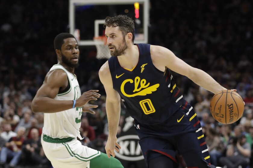 Cavaliers forward Kevin Love drives against Celtics forward Semi Ojeleye during an NBA basketball game on March 4, 2020.