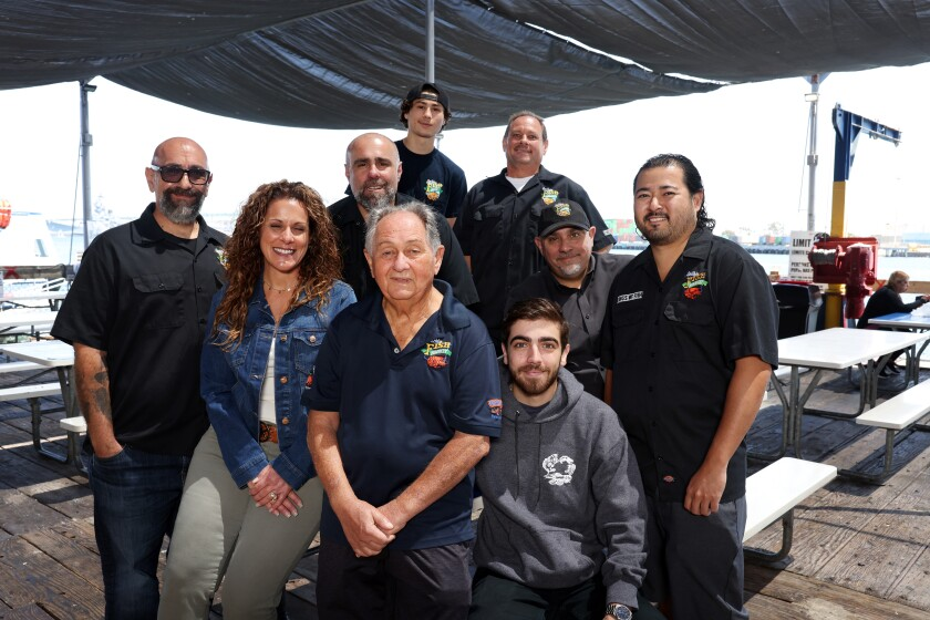 The Ungaro and Amalfitano families pose for a portrait at the San Pedro Fish Market